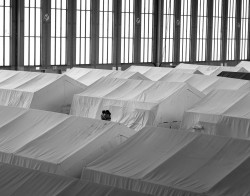 A refugee shelter at Templehof Airfield in Berlin, Germany, on December 11, 2015. Templehof is a former Nazi era airport dating back to the 1920s, and was used during the Berlin Arilift in 1948. The hangers are today being used to house up to 2,300 refugees, and while designed for transit, many families living there have been there for the entire six weeks it has been open.